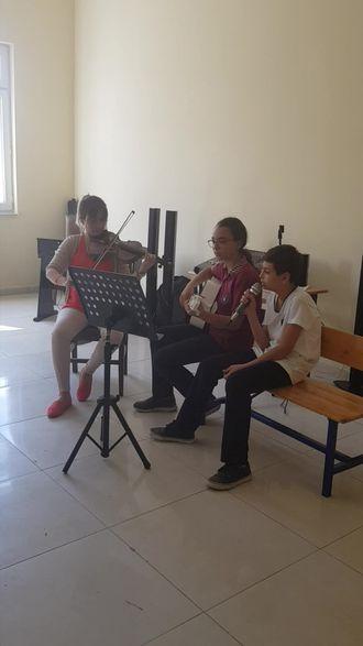 Iskenderun Nuri Üysen Ortaokulu Deniz ve Mehtap şarkı çalışması izle